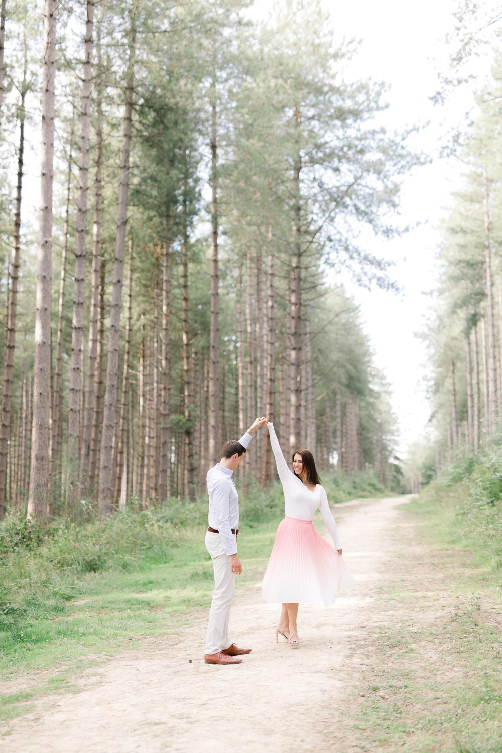 light and airy engagement shoot in woodland